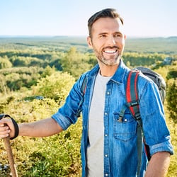 Strengthens the Immune System – Man hiking in wooded hills