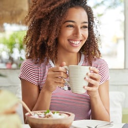 Soothes the Intestinal Tract – Woman enjoying a cup of tea and salad
