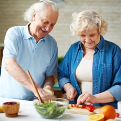 Boosts Other Cleanses – Elderly couple preparing a salad together in the kitchen
