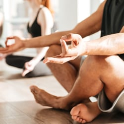 Relieves the Immune System – Man and woman practicing meditation at studio