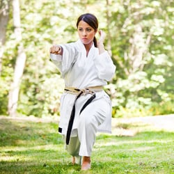 Pumps Up Blood Vessels – Woman practicing martial arts in the park