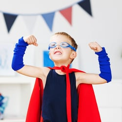 Supports the Immune System — Little boy in Superman cape