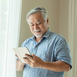 Gentle & Tastes Great – Middle-aged Asian man on iPad
