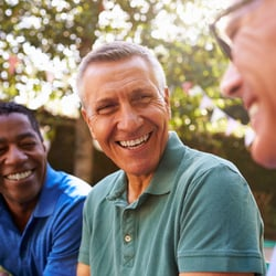 Easy for Your Body to Use – Three men chatting and laughing outdoors