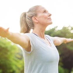 Regulates Fluid Balance – Middle-aged woman stretching outdoors