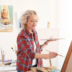 Sharpens Concentration – Older woman painting