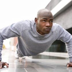 Supports the Immune System – Young man in plank stance outdoors
