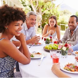 Supports Healthy Aging – Group of friends enjoying a meal al fresco