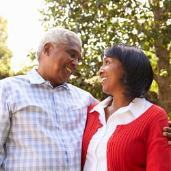 Promotes a Healthy Inflammatory Response – Couple under a tree looking lovingly into each other's eyes