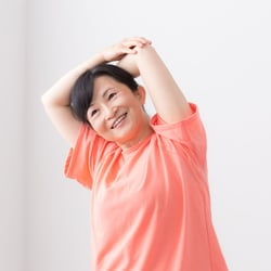 Natural Deodorant – Middle-aged Asian woman stretching with arms behind head