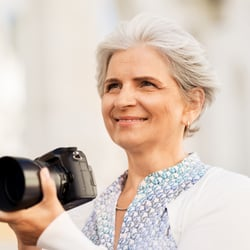 Soothes Irritation – Middle-aged woman outdoors with camera