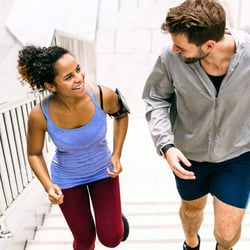 Facilitates Energy Production – Couple jogging up a flight of stairs
