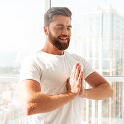 Supports the immune system – Man in mountain yoga pose with prayer hands