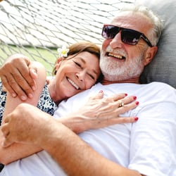 Facilitates Hormone Production – Middle-aged couple happily lounging in a hammock outdoor