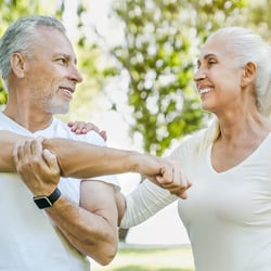 Avoid D Deficiency – Elderly couple stretching together in the park