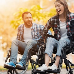 Enables a Happy Mood – A couple in wheelchairs happily playing outdoors