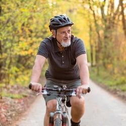 Do It the Right Way – Man biking in park.