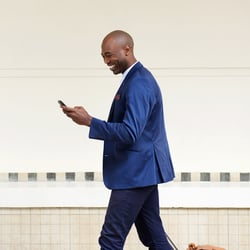 It's Easy – Man in business suit checking his mobile phone