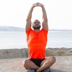 Supports Lung Function – Man sitting down stretching