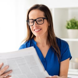Boosts Brain Health – Woman reading newspaper
