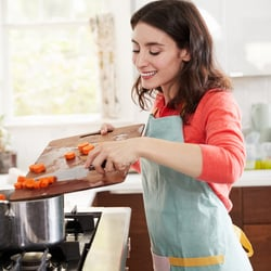 Facilitates Nutrient Absorption – Woman cooking in the kitchen